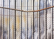 Barb wire fence and wall Royalty Free Stock Images