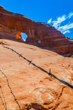 Barb Wire with Glass Arch in the background. Glass Arch against beautiful blue sky - Utah near Moab Stock Photography