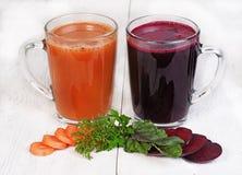 barbabietole e succo di carote Fotografie Stock Libere da Diritti