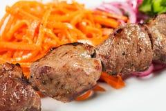 Barbacoa con la salsa y las verduras Imagen de archivo libre de regalías