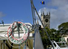 Barbados. The name of a boat with St. Michael's Anglican Cathedral in Bridgetown, Barbados in a background stock photos