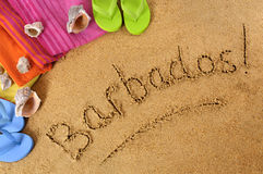 Barbados beach. Background with towel and flip flops Stock Image