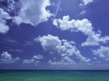 Barbados blue sky, fluffy clouds and turquoise sea Royalty Free Stock Images
