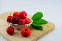 Barbados cherry. Blackberry, red and sour. Dip in salt and eat more delicious Royalty Free Stock Images