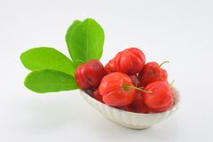 Barbados cherry. Blackberry, red and sour. Dip in salt and eat more delicious Royalty Free Stock Photos