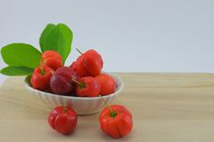Barbados cherry. Blackberry, red and sour. Dip in salt and eat more delicious Stock Image