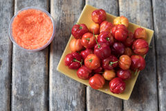 The Barbados cherry or Thai Cherry. With dip Stock Photo