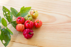 Barbados cherry on wood royalty free stock images