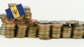 Barbados flag with stack of money coins. Barbados flag waving with stack of money coins stock footage