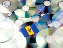 Barbados flag on top of CD and DVD pile isolated on white. Barbados flag on top of CD and DVD pile isolated Stock Photos