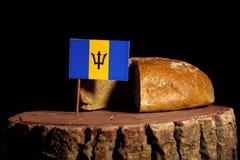 Barbados flagga på en stubbe med bröd Arkivfoto