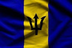 Barbados que agitan la bandera fotografía de archivo