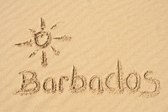 Barbados in the Sand. I picture of the sun and the word Barbados drawn in the sand royalty free stock images