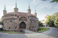 Barbakan fortress in Krakow. With florian gate in the background Royalty Free Stock Photos