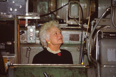 Barbara Bush, First Lady. Vintage image of the first lady Barbara Bush getting a tour of a factory.  (Image from color slide Stock Images