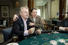 Barbara Wins a hand. Barbara Padilla grabs Jerry Springer in excitement when she wins a hand of Blackjack at Foxwoods royalty free stock photos