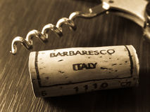 Barbaresco wine. A close-up of a corkscrew and a cork from a bottle of Italian Barbaresco red wine royalty free stock images