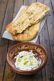 Barbari or Persian bread and strained yogurt Royalty Free Stock Image