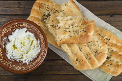 Barbari or Persian bread and strained yogurt Stock Photography