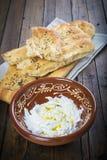 Barbari or Persian bread and strained yogurt. Barbari or Persian bread with strained yogurt, greek yogurt, yogurt cheese or labneh Stock Photo