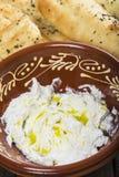 Barbari or Persian bread and strained yogurt. Barbari or Persian bread with strained yogurt, greek yogurt, yogurt cheese or labneh Stock Image