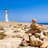 Barbaria formentera Lighthouse make a wish stones Royalty Free Stock Images