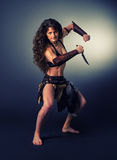 Barbarian woman warrior. Ritual dance with a knife. Stock Photo