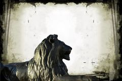 Barbary lion at Trafalgar Square in London on gray grunge background. Sculpture of   Barbary  lion at Trafalgar Square in London on gray  grunge frame background Stock Photography