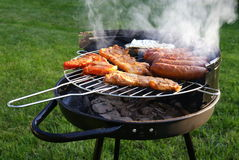 Barbecue. Some meat on grill during barbecue, outdoors shoot Stock Image