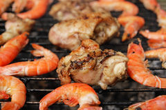 Barbecue. Shrimps and pork are fried on a brazier royalty free stock image