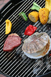 Barbecue. Yammy BBQ. Colorful. Paprika, corn, meat, scalop on the griil Stock Photos