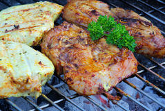 Barbecue. Grilling steak with parsley Royalty Free Stock Photos