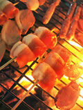 Barbecue. Roasting bacon and duck breast skewers in a barbecue meal Royalty Free Stock Photos