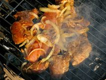 Barbecue. Smoke over barbecue with onion stock image
