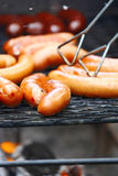 Barbecue. Close-up of grilled sausages on wire rack stock photography