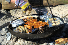 Barbecue. Sausage and meat is prepared on a barbecue grill Royalty Free Stock Photos