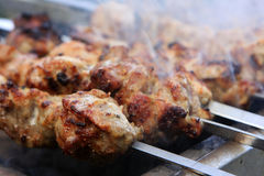 Barbecue. Home made sashlik cooking on the barbecue grill Royalty Free Stock Image
