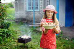 Barbecue. An image of a girl with meat for barbecue stock image