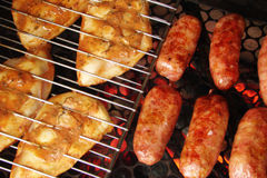 Barbecue. Grilled chicken and Brats Royalty Free Stock Photography