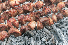 On the barbecue. Barbecue grill meat in cooking process Royalty Free Stock Photography