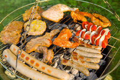 Barbecue. On a hanging grill in the evening sunshine royalty free stock photo