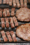 Barbecue. This is a closeup shot of bundle of pljeskavica i cevapcici pork meat on the grill Stock Photography