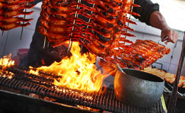 Barbecue. A man is barbecuing chicken wings royalty free stock photography