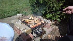 Barbecue amongst the garden. Garden barbecue amongst the bacon, chicken, burgers stock photos