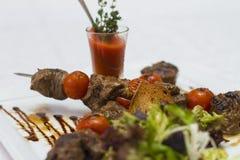 Barbecue banquet. Of delicious juicy pork Stock Photos