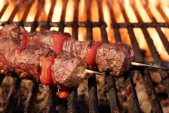 Barbecue Beef Kebabs On The Flaming Grill Close-up Stock Photo