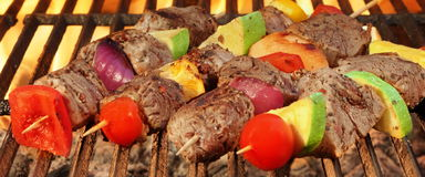 Barbecue Beef Kebabs On The Hot Grill Close-up. Royalty Free Stock Photography