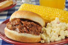 Barbecue beef sandwich with corn on the cob Royalty Free Stock Photography