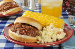Barbecue beef sandwich with corn on the cob Royalty Free Stock Image