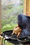 Barbecue Beer Chicken. Marinated and Barbecued Chicken stuffed with a Beer Can in Sweden Stock Photos
